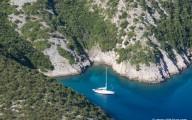 Sailboat moored in a sheltered Hvar bay